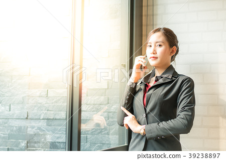 Business woman use cell phone 39238897