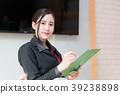 Business woman holding Folder tablet 39238898