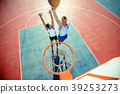 High angle view of basketball player dunking 39253273
