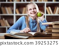 Teenage girl in a library 39253275
