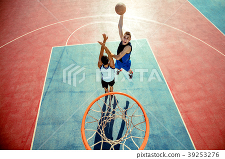 High angle view of basketball player dunking 39253276