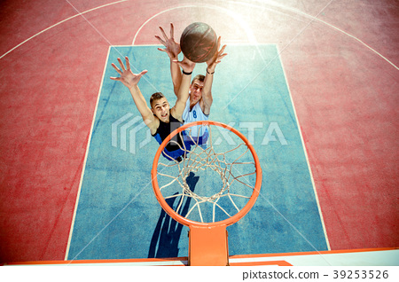 High angle view of basketball player dunking 39253526