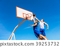 Young Basketball street player making slam dunk 39253732