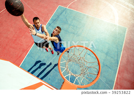 High angle view of basketball player dunking 39253822