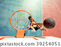 High angle view of basketball player dunking 39254051