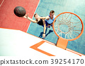High angle view of basketball player dunking 39254170