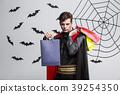 Vampire Halloween Concept - Happy handsome 39254350