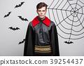 Vampire Halloween Concept - Portrait of handsome 39254437