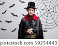 Vampire Halloween Concept - Portrait of handsome 39254443