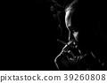 woman smoking cigarette 39260808