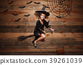 Halloween Witch concept - little caucasian witch 39261039