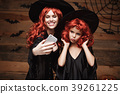 Halloween Concept - Beautiful caucasian mother and 39261225