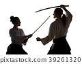 Man and woman fighting and training aikido on 39261320