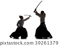 Man and woman fighting and training aikido on 39261379