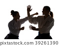 Man and woman fighting at Aikido training in 39261390