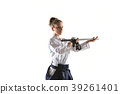 Aikido master practices defense posture. Healthy 39261401