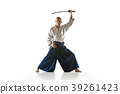 The young man are training Aikido at studio 39261423