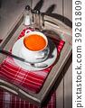 Fresh tomato soup in a white bowl. 39261809