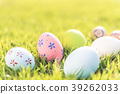 Closeup Colorful Easter eggs on green grass field 39262033