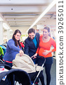 Woman, man, and sales lady in baby store 39265011