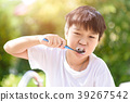 Preteen Asian boy brush his teeth 39267542