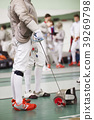 Fencer in white costume with rapier and protective 39269798