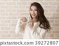 Woman blowing an ocarina 39272807