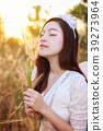 angel woman in a grass field with sunlight 39273964