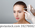 woman getting cosmetic injection 39276682
