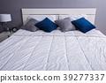 bed in bedroom in home 39277337