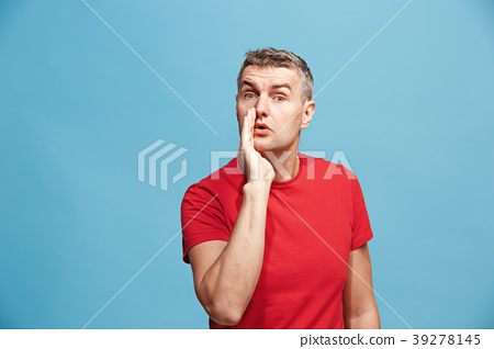 Isolated on pink young casual man shouting at 39278145
