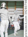 Two young fencers fighting on the fencing 39280798