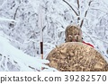 Spartan man took shelter in winter forest. 39282570