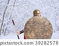 Spartan warrior in winter forest looks in camera . 39282578