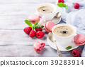 Cup of coffee with french raspberry macaroons 39283914