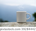 White coffee mug in the morning time. 39284442