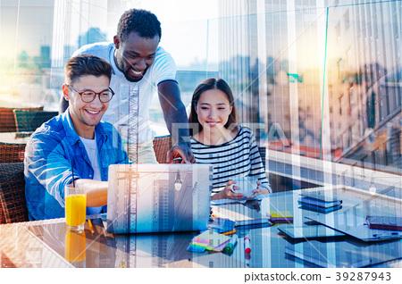 Cheerful students having fun during preparation 39287943