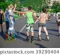 Young people in roller skates in the park  39290404