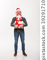 Christmas Concept - Happy young man with beard 39291710