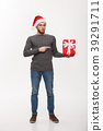 Christmas Concept - Happy young man with beard 39291711