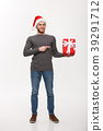 Christmas Concept - Happy young man with beard 39291712