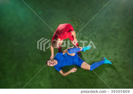 Male soccer player suffering from leg injury on 39305809