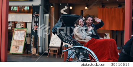 Foreign tourists on a rickshaw 39310612
