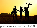 Military soldier holding weapons overhead after. 39315198