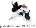 The two men fighting at Aikido training in martial 39319771