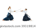 Man and woman fighting and training aikido on 39319814