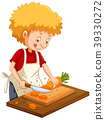 Man chopping carrot on cutting board 39330272