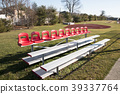 Portable stands with red seats on top 39337764