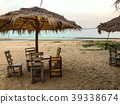 Side of chairs set with umbrella on the beach back 39338674