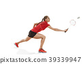 Young woman playing badminton over white 39339947